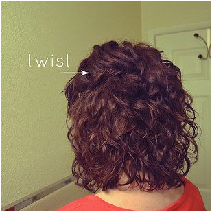 Twist and pin back the front sections of a curly bob