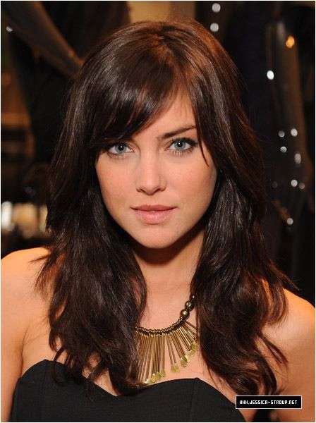Jessica Stroup with side swept bangs and wavy medium to long hair fringe brunette brown hairstyle