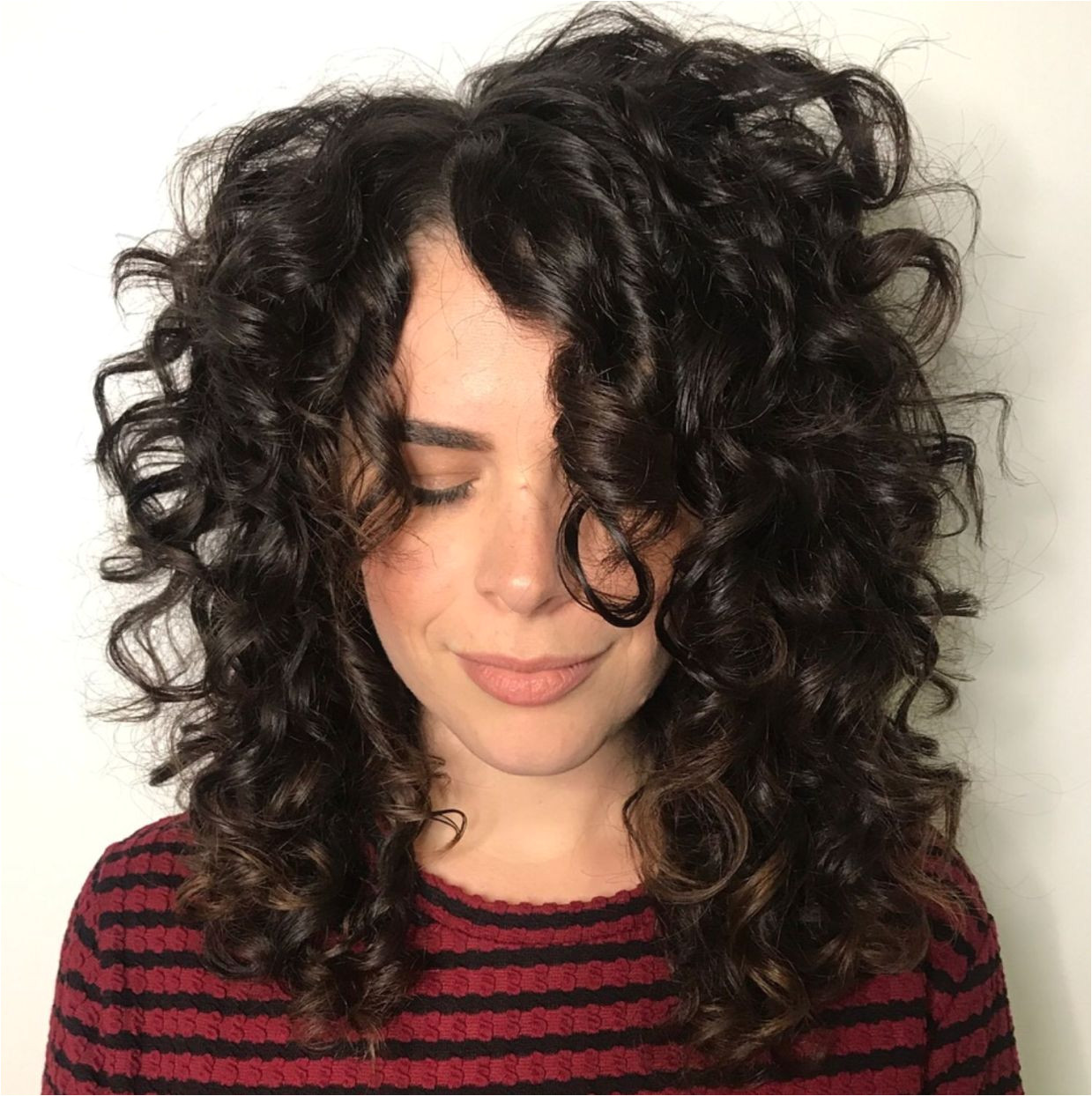 Mid Length Curly Hairstyle with f Centre Part