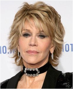 medium layered blonde messy hairstyle with bangs for older women over 60