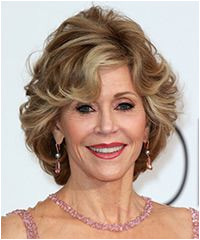 Jane Fonda Short Straight Formal Hairstyle with Side Swept Bangs Light Caramel Brunette Hair Color with Light Blonde Highlights