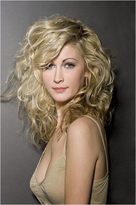long wavy layered hairstyles with side bangs
