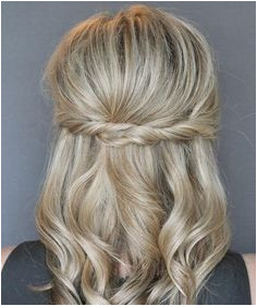 This easy twist hairstyle takes no more than five minutes to achieve yet it is infinitely more special than your standard half up look