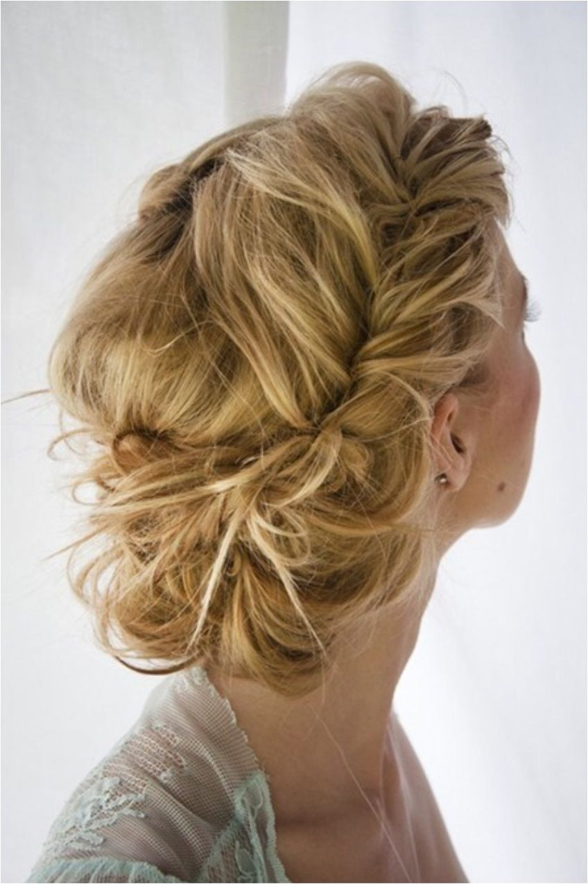 Prom hairstyle Fish tale braid into a messy bun