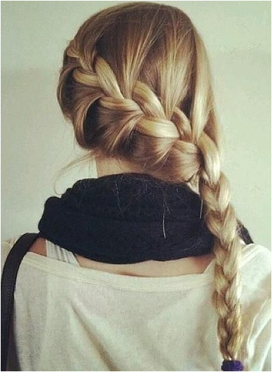 Braids are a classic go to hairstyle for summer but switch things up with a French braid styled to the side