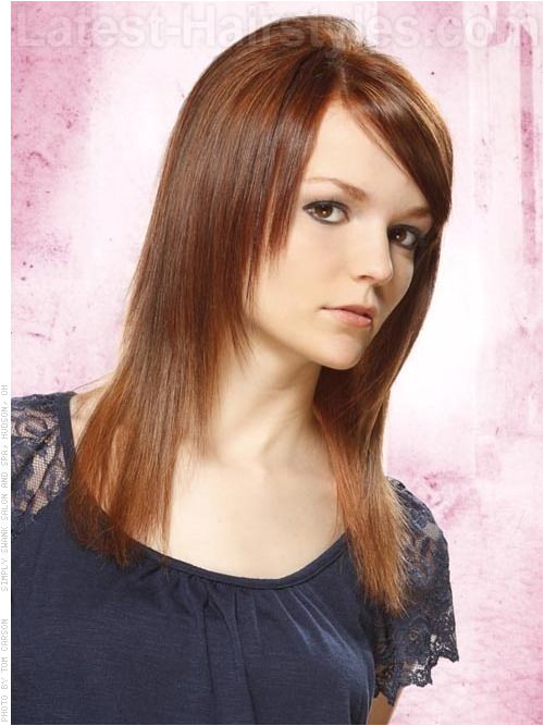 Tapered Straight Hair only layered in front with side swept bangs no layers in back increases body