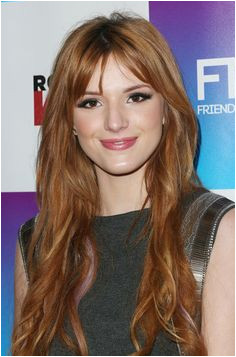 Bella Thorne Grow out your fringe in style by adding a center part like Bella