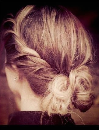 Give the messy bun a little makeover by twisting the sides and folding into the bun This hairstyle has be e a new quick after shower routine for me