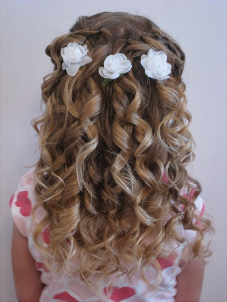 Flower girl with blue flowers in her half up hairstyle