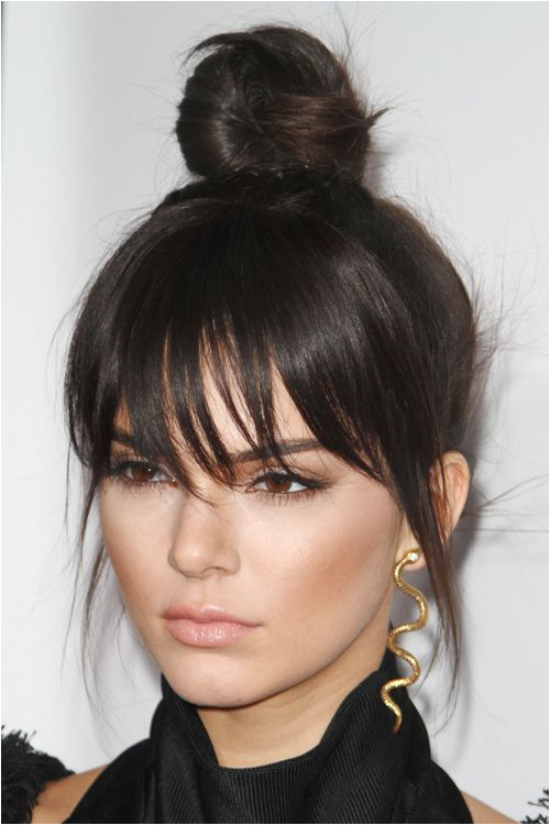 Kendall Jenner Straight Dark Brown Bun Choppy Bangs Hairstyle