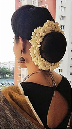 What a beautiful large low bun with real flower gajra Care however should be taken before adopting such hairstyles as due to it s high static charge