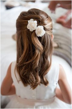 How pretty is this mini French twist pulled half up for a little girls formal