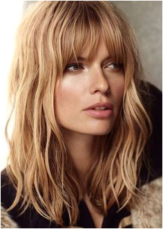 Check out this Long Bob Hairstyles for Women with Oval Face for Coarse Wavy Sunflower Blonde Hair Color with Bangs The post Long Bob Hairstyles for Women