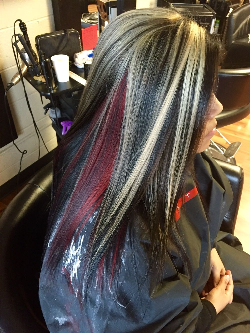 Chunky blonde highlights With all over black and a red halo