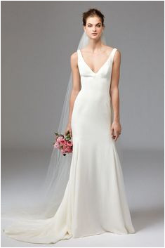 Watters Leona wedding gown Clean classic and chic Leona is ideal for the modern minimalist This V Neck Silk Geor te gown is lined with Stretch