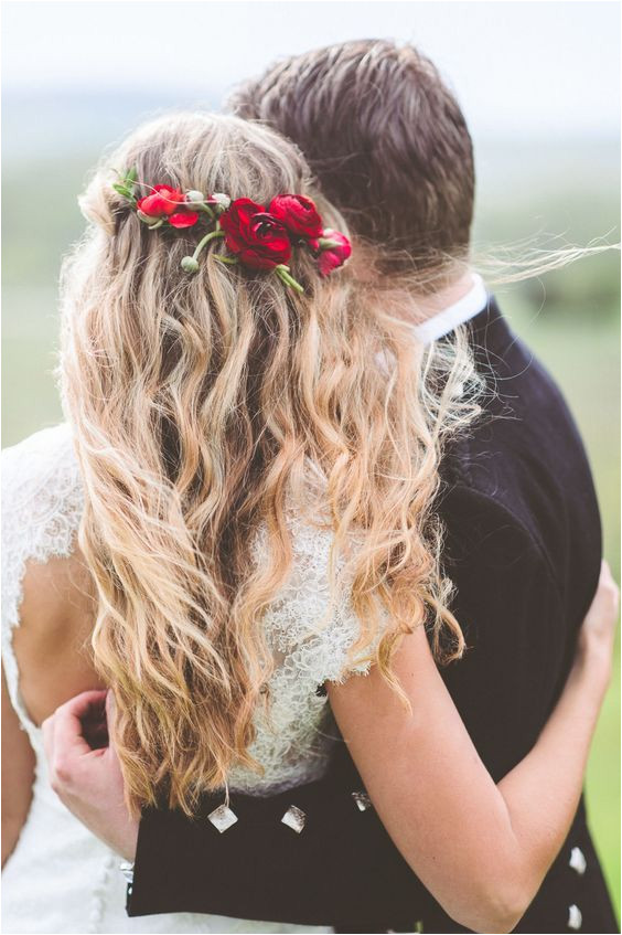 Red flower detail in wedding hairstyle with long messy waves