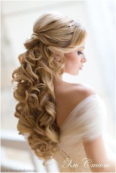 Looking for those wedding curls Pin your hair up into a half up do and finish it off with luscious curls