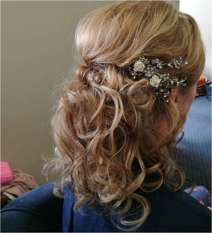 Half up half down bridal hair style Bit of height and a lovely side sweep at the front Curls were made using heated rollers and then individually styled