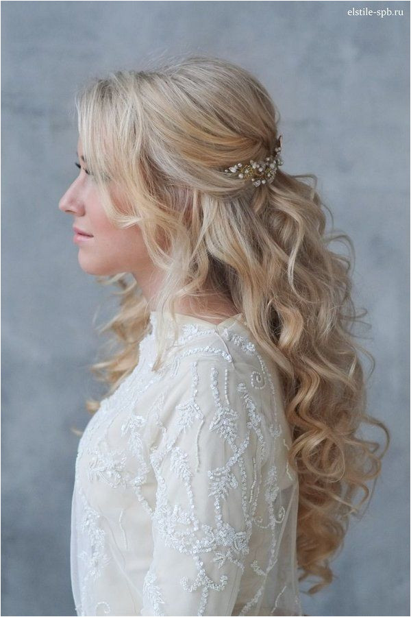 Bridal Hairstyles Inspiration long wavy half up half down wedding hairstyle with pearl headpiece Long