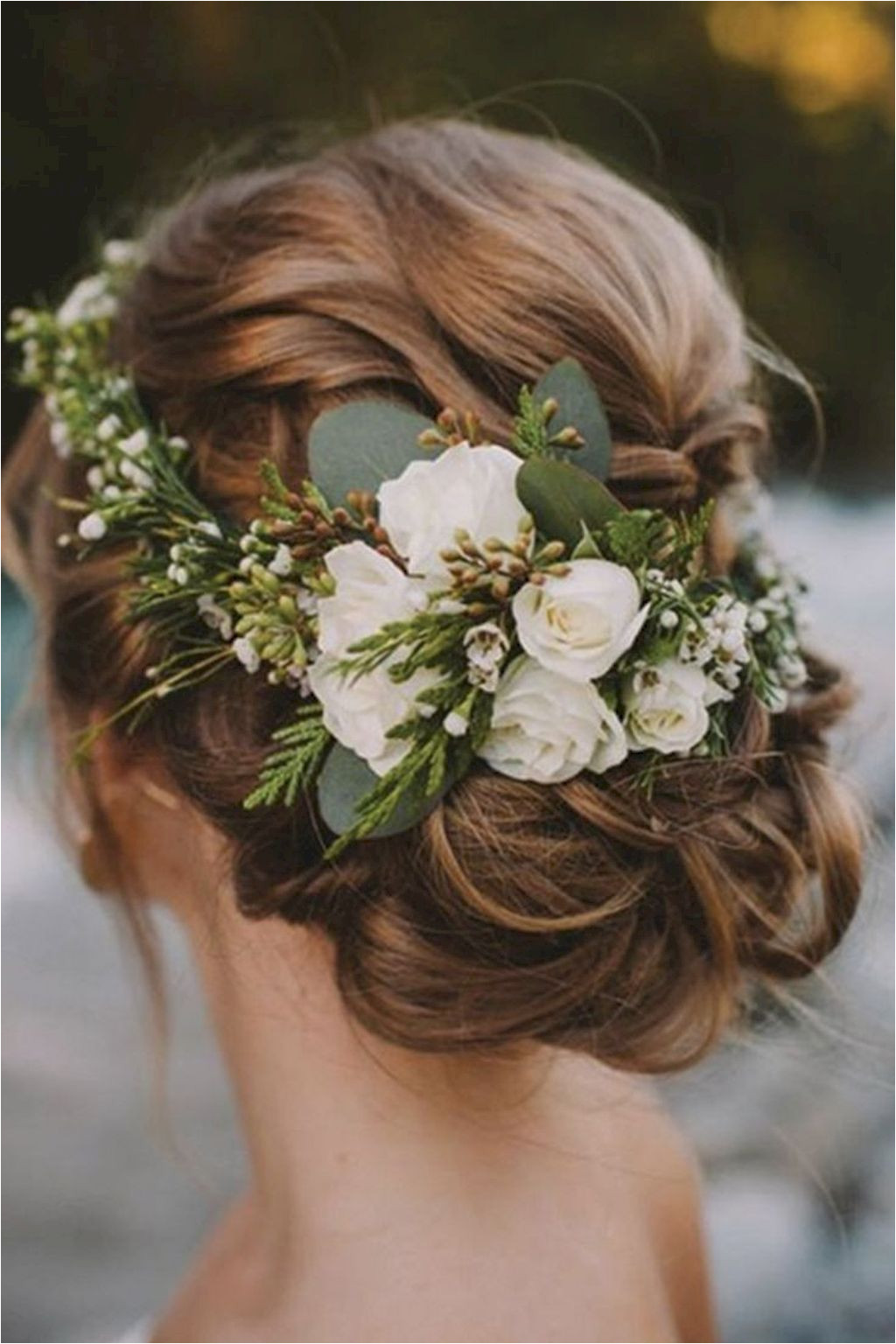 Flower crowns are a winning winter wedding hair accessory Maybe not quite this big of a piece but i like the greenery Nice 96 Bridal Wedding Hairstyles