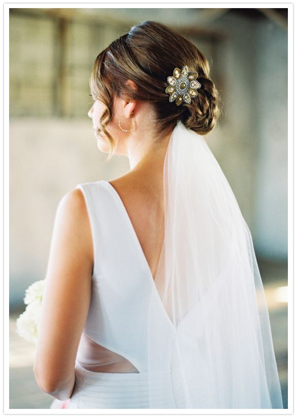 wedding hair style low bun veil underneath clip side ringlets