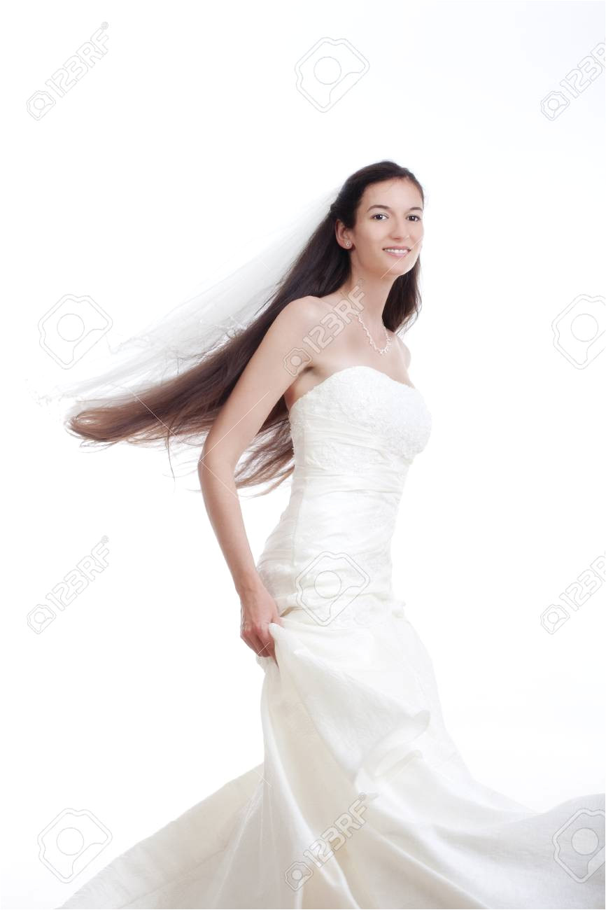portrait od a bride with long dark hair in wedding dress isolated on white Stock