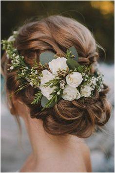 Flower crowns are a winning winter wedding hair accessory beautifulweddingflowers Bridal Updo Wedding
