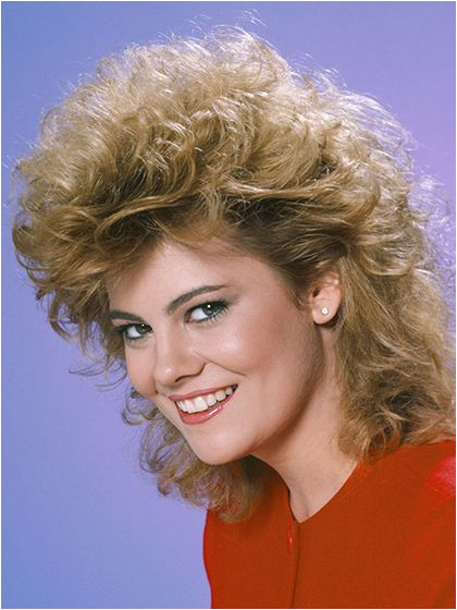 13 Hairstyles You Totally Wore in the 80s Lisa Whelchel s permed fe mullet
