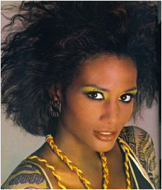 Beverly Johnson s 1980s Statement Big hair and bright colorful eye shadow which matches