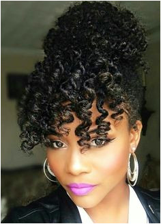 e of the cutest naturalhair hairstyles with a bun and bangs Natural Bun Hairstyles