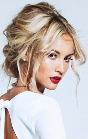 We love everything about this look the classic red lip and the tousled hair UpdosLoose