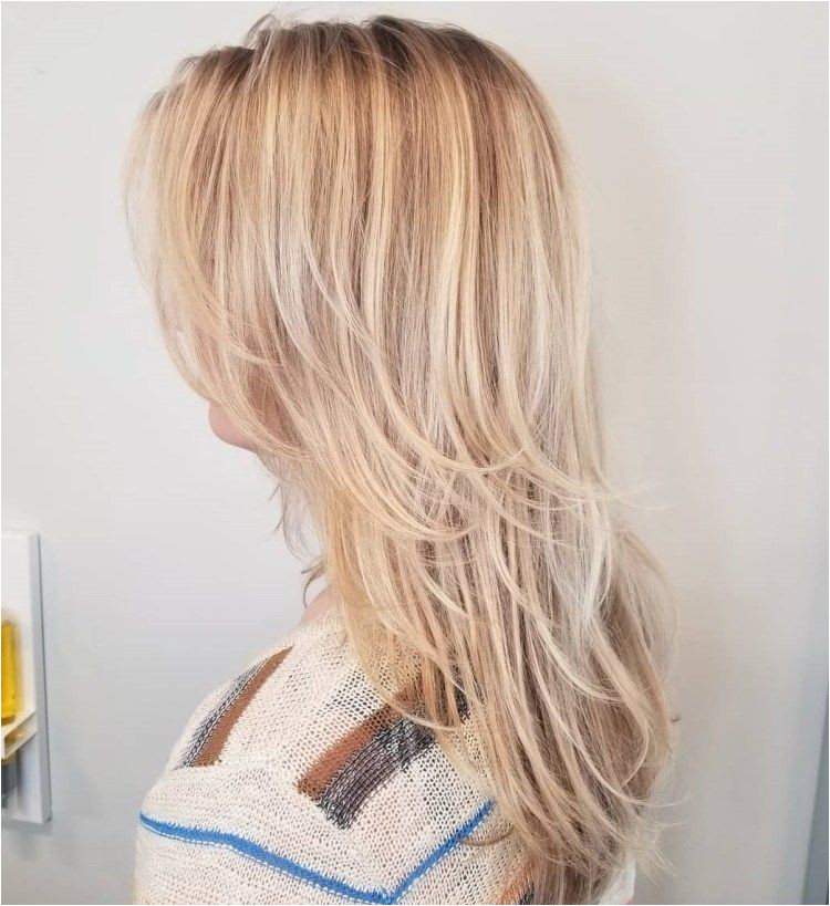 Sliced Blonde Haircut For Longer Hair