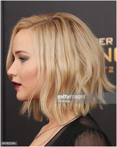 Actress Jennifer Lawrence hair detail attends the The Hunger Games Mockingjay Part 2 New York premiere at AMC Loews Lincoln Square 13 theater on