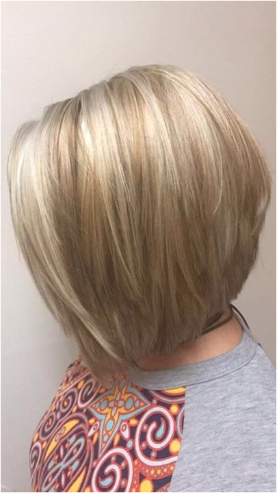 Stylist Beth Created Platinum Blonde highlights and a Honey Blonde low light Cut is