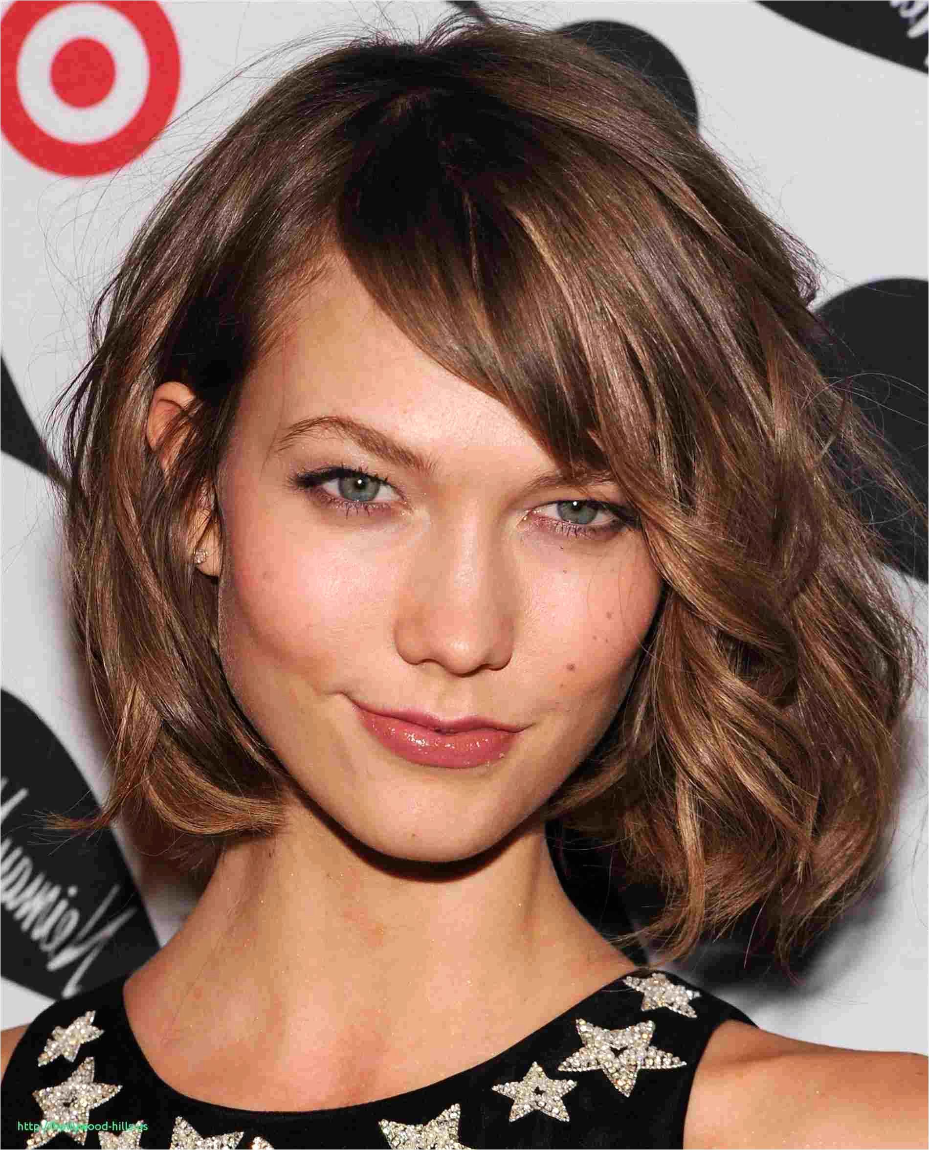 Medium Haircut with Bangs and Layers