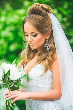 We picked up wedding hairstyles with veil for updos and half down bun long and short hair special for you It is an undisputed symbol of every bride