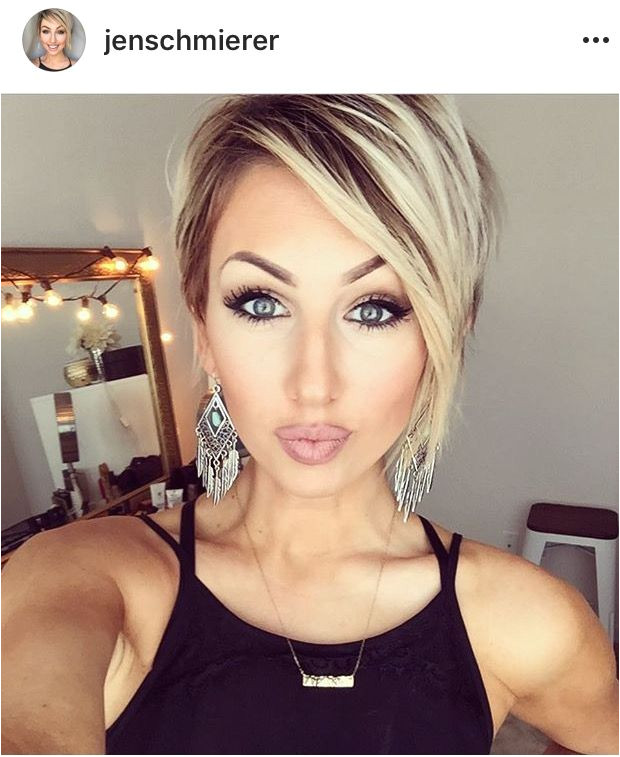 This woman is gorgeous her make up is perfect and her hair is the perfect cut color and style for her