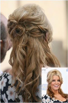 Playing up her southern roots this Clampet inspired half updo is all country and totally cute