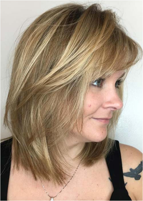 Haircuts & Hairstyles for Women Over 50 Medium Fringed Lowlights