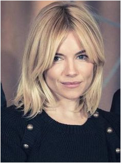 I think these bangs would work with my curly hair just need to be longer Sienna Miller looked casual chic as she stepped out for photo call along with her