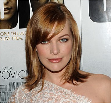 This flippedout hairstyle isn t your stiff 50shousewife style ce your shoulderlength haircut