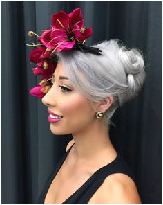 In this post I cover the best races hairstyles for fascinators Tips on how to wear a fascinator and popular styles for long hair short hair and hair down