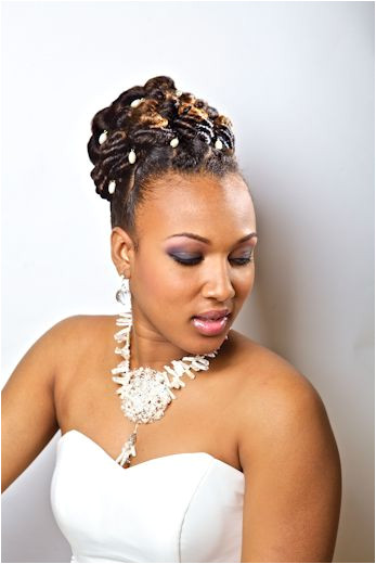 In Love with Locs Styles by Maria Thompson of Twist and Curves Salon as featured on essence