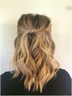 Medium length beach waves Top pieces knotted and pinned Medium Hair Do Beach