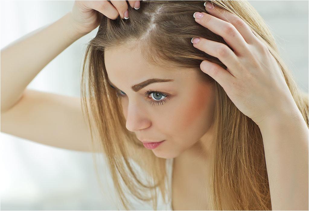A woman checking her hair
