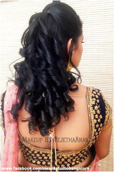 Indian bride s bridal engagement hairstyle by Swank Studio Saree Blouse… Saree Hairstyles