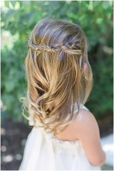 Flower girl hair with pinned up braids Stylist Marcy Harmon photo by