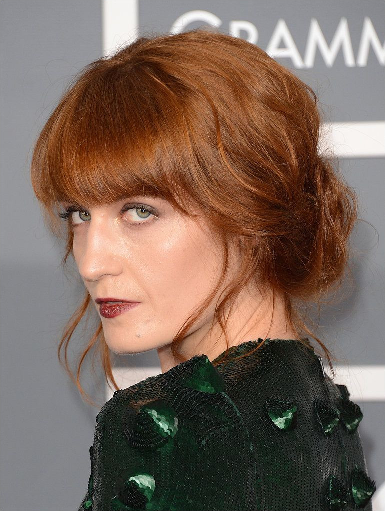A fan of the full figured fringe Florence Welch wears bangs that cascade into a face frame making them much more versatile