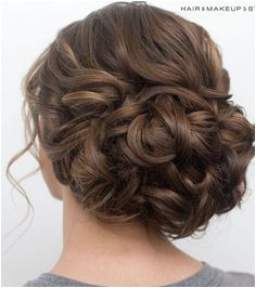 loose curls on the top wave into bun Classic Updo Hairstyles Classic Hair Updo