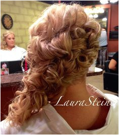 Bridal updo with cascading curls off one shoulder